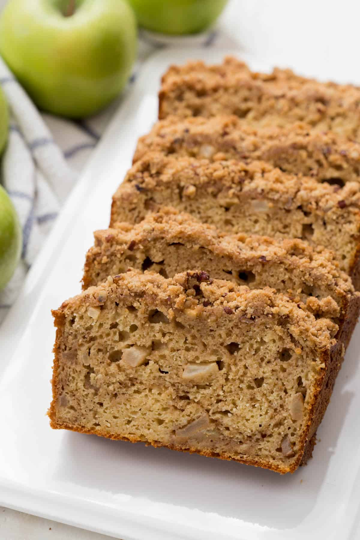 five slices of apple cinnamon bread on a white plate