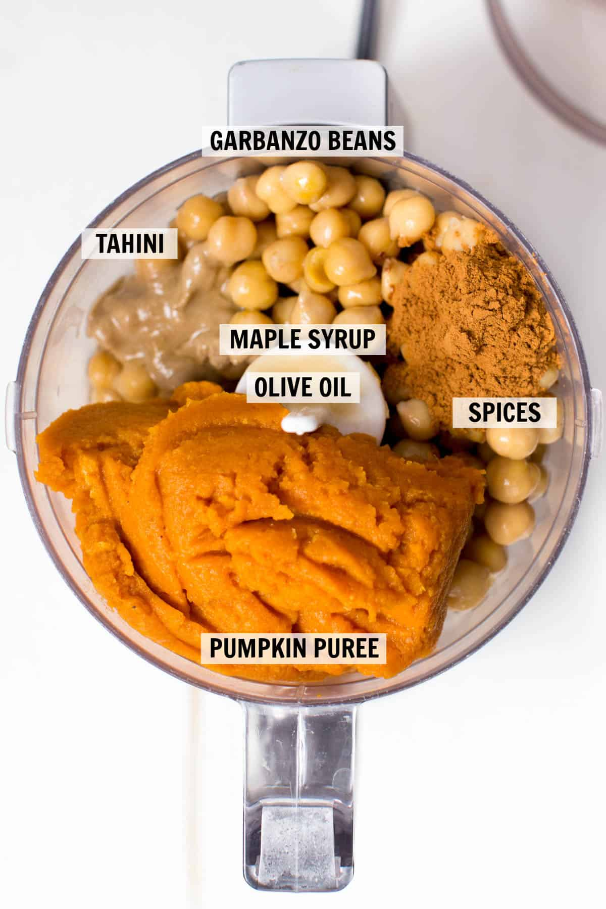 all of the ingredients for pumpkin hummus in a food processor