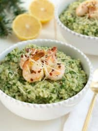 Lemon Garlic and Spinach Risotto with Sautéed Shrimp is a classic recipe that combines everything you love about creamy risotto with lemon garlic and hearty spinach. The creamy risotto is topped with a simple sautéed lemon garlic shrimp to create an entire meal for any day of the week!
