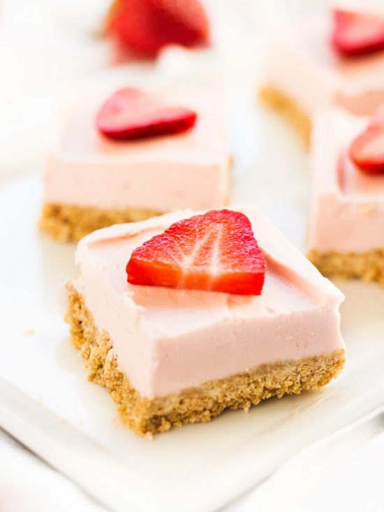 Strawberry cheesecake bars with graham cracker crust is a no bake recipe for Valentine's Day #cheesecake #dessert