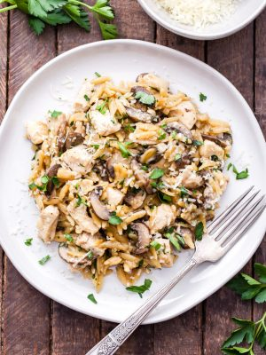 Parmesan Herb Chicken, Mushroom and Orzo Skillet is a one pan, easy to make, comfort food dinner the whole family will love! #dinner #easyrecipe #chicken #orzo