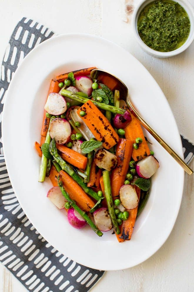 Charred Spring Vegetables with Herbed Carrot Top Dressing is a simple, easy and delicious dish! Your favorite spring vegetables are charred and then topped with a herbed carrot top dressing. #Easter #dinner #sidedish #healthyrecipe #springvegetables #carrot