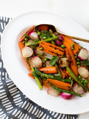 Charred Spring Vegetables with Herbed Carrot Top Dressing is a simple, easy and delicious dish! #spring #vegetables #sidedish #carrottop #dressing #recipe