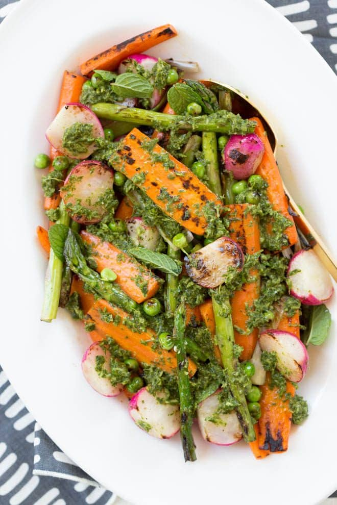 Charred Spring Vegetables with Herbed Carrot Top Dressing is a simple, easy and delicious dish! Your favorite spring vegetables are charred and then topped with a herbed carrot top dressing. #springvegetables #carrottop #dressing #healthyrecipe #Easter #spring #dinner