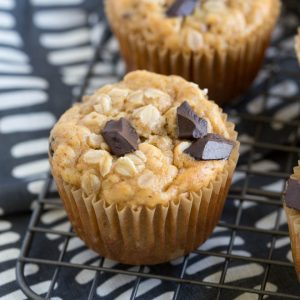 chocolate chunk oatmeal muffins sitting on a baking rack