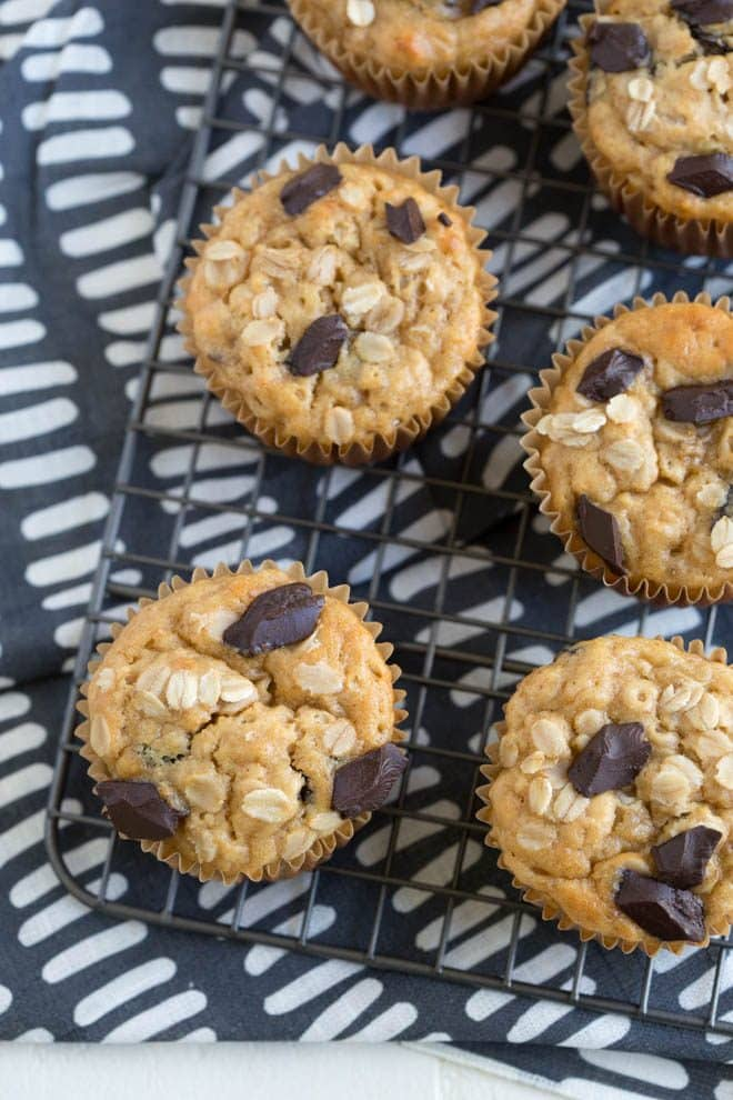 Chocolate Chunk Peanut Butter Banana Oat Muffins are made with wholesome ingredients and are naturally gluten free and vegan! #chocolate #banana #peanutbutter #oat #muffins #recipe #breakfast #snack #healthy