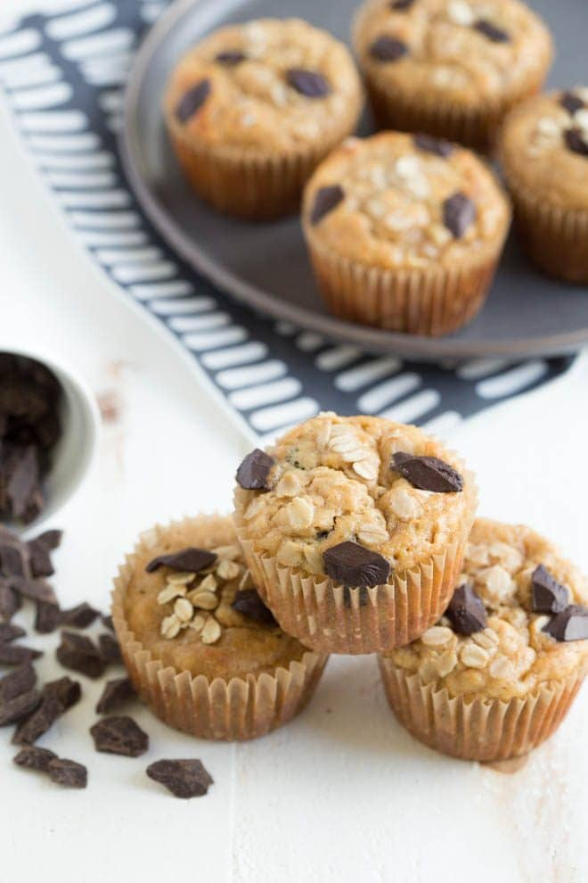 Chocolate Chunk Peanut Butter Banana Oat Muffins are made with wholesome ingredients and are naturally gluten free and vegan. Kids and adults love them! #chocolate #banana #peanutbutter #oat #muffins #recipe #breakfast #snack