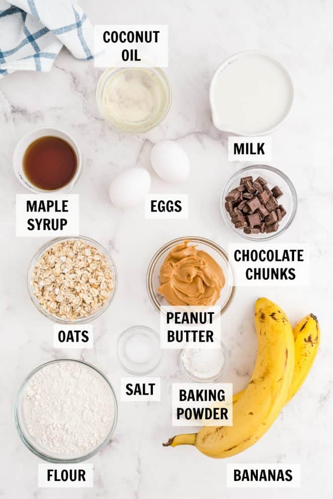 ingredients for oat muffins on a white tabletop