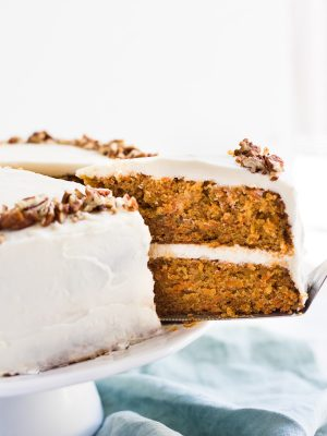 Classic Carrot Layer Cake with Cream Cheese Frosting is moist, flavorful and garnished with chopped pecans. This recipe is a must for Easter or spring! #carrot #cake #recipe #dessert #cakerecipe #carrotcake #classic #layercake #Easter #Easterrecipe #spring