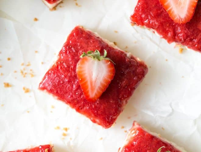 Mango Strawberry Cheesecake Bars are an irresistible treat made with ripe mango, strawberries, cream cheese, sour cream and a few other simple ingredients. They are the perfect summer dessert and combine a light and creamy mango cheesecake with strawberry topping! #mango #cheesecake #strawberry #bars #dessert #summerrecipe #dessertrecipe #recipe