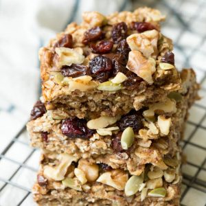 a stack of three trail mix breakfast bars sitting on a baking rack