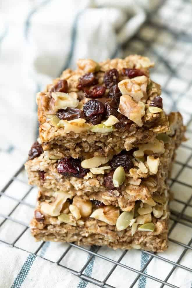 Trail Mix Breakfast Bars are made with a banana-walnut layer mixed together with your favorite trail mix ingredients including chocolate chips, dried fruit, seeds and walnuts! #trailmix #breakfast #bars #californiawalnuts #healthy #recipe