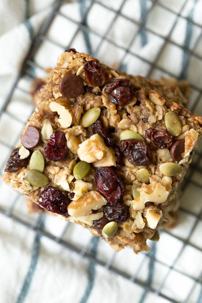 Trail Mix Breakfast Bars are made with a banana-walnut layer mixed together with your favorite trail mix ingredients including chocolate chips, dried fruit, seeds and walnuts! #trailmix #breakfast #bars #californiawalnuts #healthy #recipe #snackrecipe