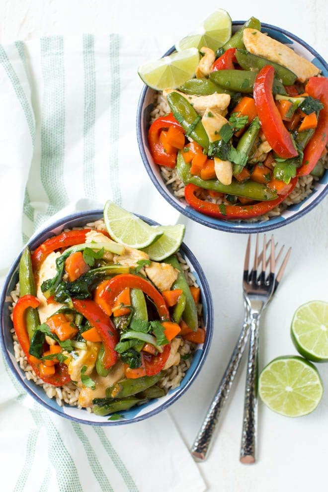 Cilantro Lime Chicken Teriyaki Stir Fry is a flavorful dinner recipe made in less than 30 minutes! Combine chicken, baby bok choy greens, fresh vegetables and a teriyaki stir fry cilantro lime sauce to create a meal the entire family will love.#dinner #recipe #chicken #stiryfry