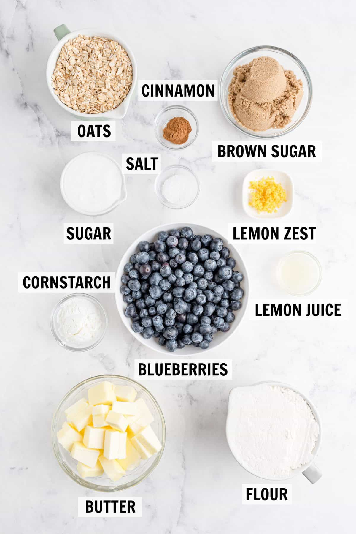 all of the ingredients for blueberry crumble bars on a countertop
