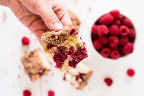 Raspberry coffee cake is bursting with raspberry flavor and topped with a sweet buttery crumble.