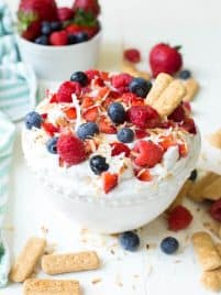 Berry Cream Pie Dip is a delectable treat made with whipped coconut cream and fresh strawberries, blueberries and raspberries. It is dairy free, gluten free and perfect for dessert or snack.@naturipe #dessert #coconutcream #vegan #dip