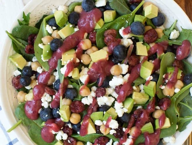 Combine the freshest flavors to create thisCranberry Blueberry and Goat Cheese Salad with Cranberry Vinaigrette Dressing. Pack in a mason jar for on-the-go or serve in a large bowl for a crowd. This antioxidant packed salad will please everyone! #salad #recipe #cranberry