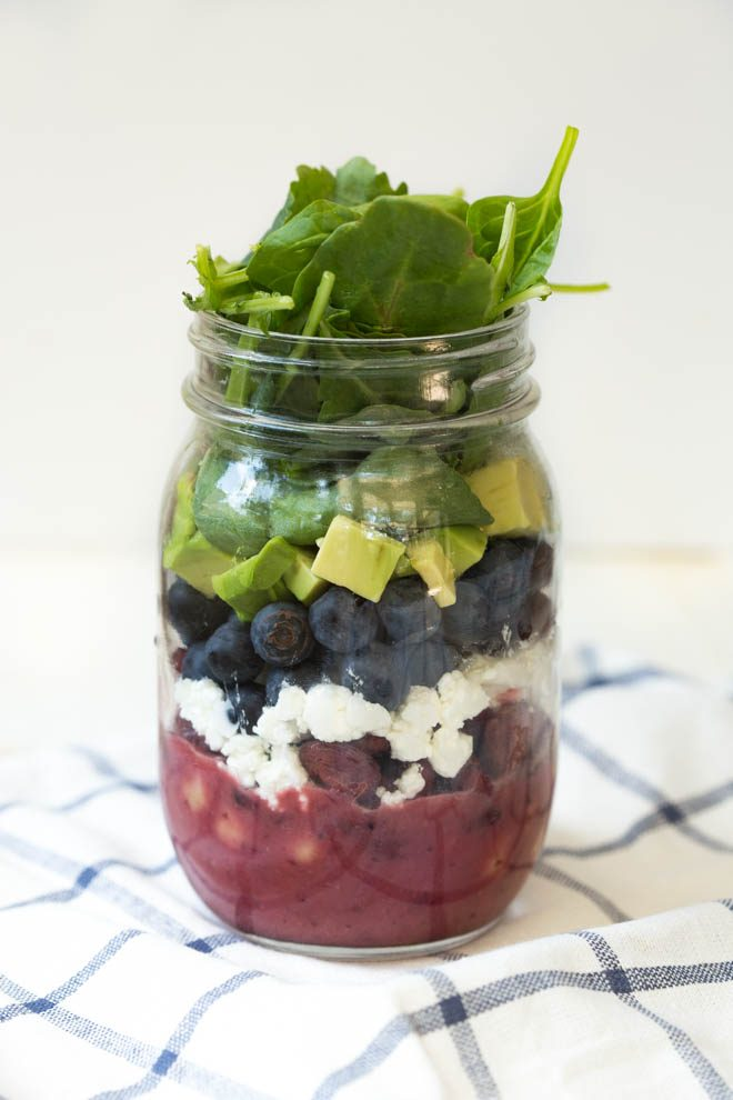 Combine the freshest flavors to create thisCranberry Blueberry and Goat Cheese Salad with Cranberry Vinaigrette Dressing. Pack in a mason jar for on-the-go or serve in a large bowl for a crowd. This antioxidant packed salad will please everyone! #masonjar #salads #recipe #cranberry #blueberry #avocado