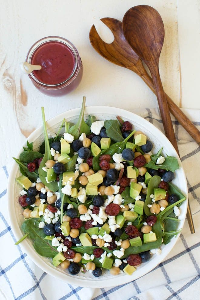 Combine the freshest flavors to create thisCranberry Blueberry and Goat Cheese Salad with Cranberry Vinaigrette Dressing. Pack in a mason jar for on-the-go or serve in a large bowl for a crowd. This antioxidant packed salad will please everyone! #masonjar #salad #recipe
