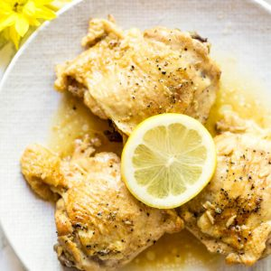 Lemon Garlic Butter Chicken Thighs are made in the Instant Pot with a few simple ingredients! The recipe is low carb and packed with flavor. #healthy #chicken #recipe #instantpot #lowcarb #dinner