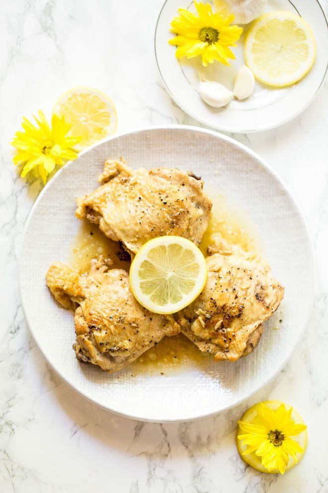 Lemon Garlic Butter Chicken Thighs are made in the Instant Pot with a few simple ingredients! The recipe is low carb and packed with flavor. #lemon #garlic #butter #chicken #thighs #instantpot #pressurecooker #recipe