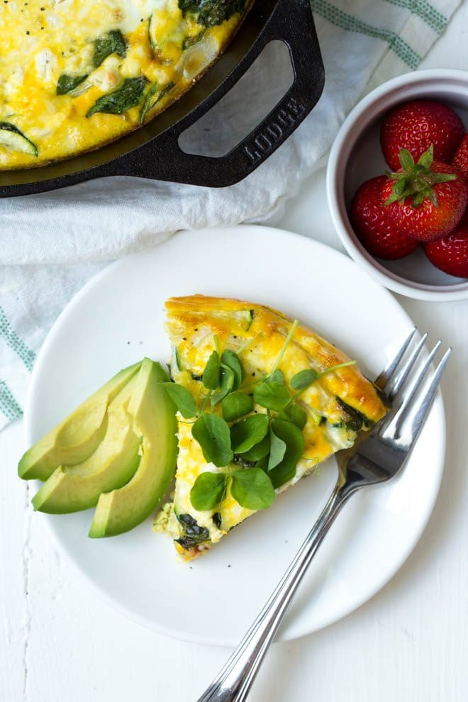 Combine a few simple ingredients to create a Summer Vegetable Frittata! Made with summer squash, goat cheese and mixed greens, this frittata is perfect for brunch. #breakfast #skillet #recipe #frittata