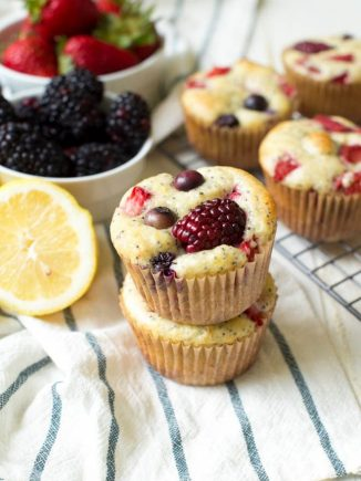 Triple Berry Lemon Poppyseed Muffins are made with your favorite berries, fresh lemons and a few simple ingredients! These muffins are packed with flavor and are the perfect breakfast or snack. #breakfast #berry #snack #lemon #recipe