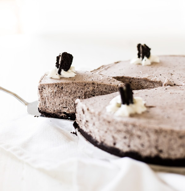 A slice of cookies and cream cheesecake.