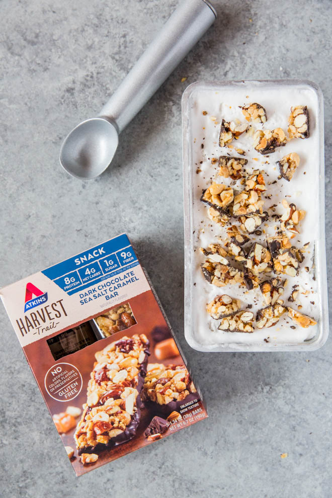 No Churn Coconut Milk Vanilla Ice Cream is made with only four ingredients and is topped with delectable chunks of Atkins Harvest Trail Dark Chocolate Sea Salt Caramel Bar! This dessert is low carb and naturally gluten free. #icecream #coconutmilk #summer #dessert #lowcarb #recipe #Atkins #nochurn