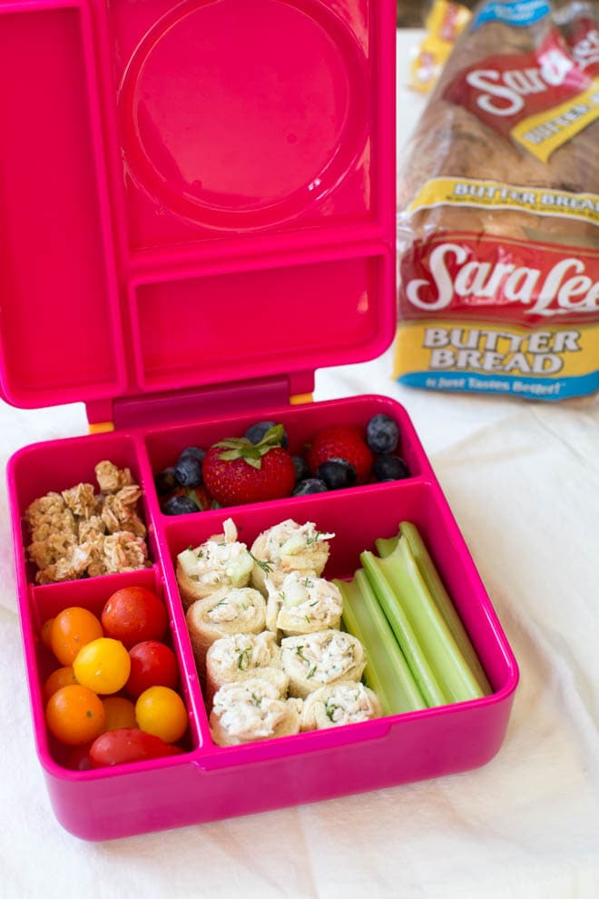Cucumber Dill Chicken Salad Roll Ups are an easy back-to-school recipe that is perfect to pack in a lunchbox! Combine a few simple ingredients to make this flavorful snack, appetizer or lunch option. #chickensalad #kids #lunch #backtoschool #lunchbox #rollups #schoollunch #healthy #recipe #teasandwiches