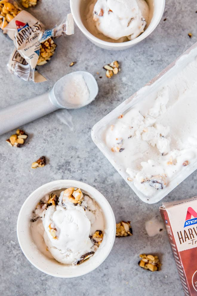 No Churn Coconut Milk Vanilla Ice Cream is made with only four ingredients and is topped with delectable chunks of Atkins Harvest Trail Dark Chocolate Sea Salt Caramel Bar! This dessert is low carb and naturally gluten free. #icecream #coconutmilk #summer #dessert #lowcarb #recipe #Atkins #chocolate #caramel