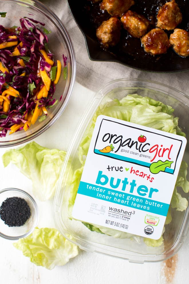 Wrap saucy chicken meatballs and fresh mango slaw with crunchy butter lettuce to create these Asian Chicken Meatball Lettuce Wraps with Mango Slaw! Enjoy them for lunch, dinner or as an appetizer. #chicken #meatballs #dinner #lunch #appetizer #asian #healthy #recipe #organicgirl