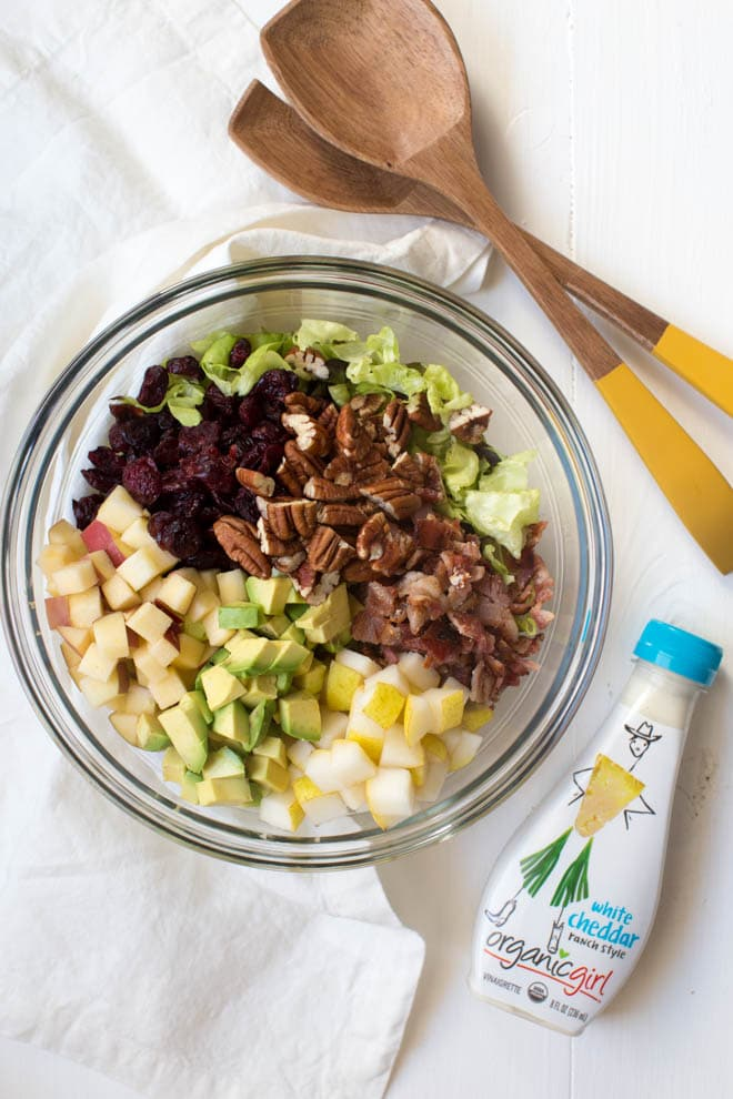 Autumn Chopped Salad is made with the freshest fall flavors including apples, pears, cranberries, bacon, avocado, butter greens and a creamy white cheddar dressing! #apple #pear #autumn #fall #salad #healthy #organicgirl #greens #fall #recipe