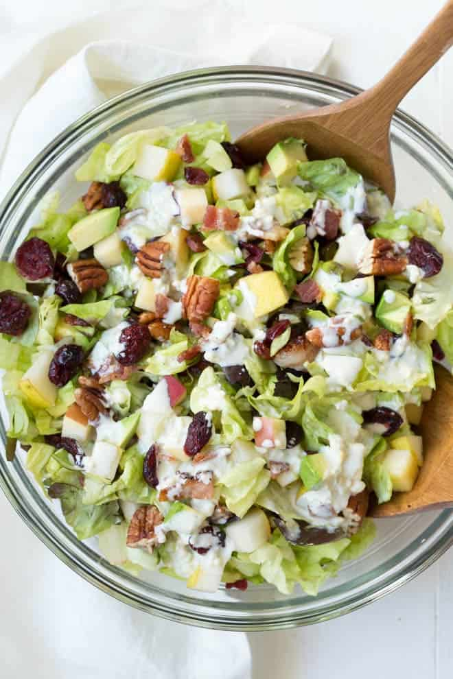 Autumn Chopped Salad is made with the freshest fall flavors including apples, pears, cranberries, bacon, avocado, butter greens and a creamy white cheddar dressing! #apple #pear #autumn #fall #salad #healthy #organicgirl #greens #fall #mealprep