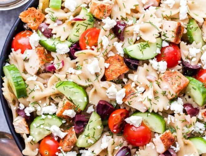 This Greek Chicken Pasta Salad is a healthy main dish pasta salad that's delicious any time of year! Loaded with cucumbers, tomatoes, kalamata olives and of course, plenty of feta cheese! #pastasalad #greek #chicken #healthydinner