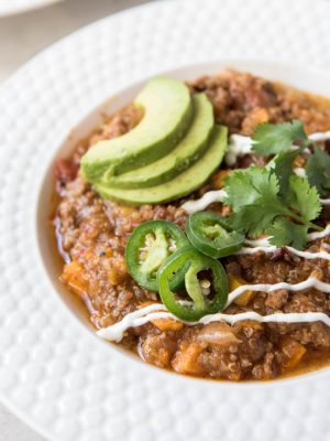TTurkey Sweet Potato Quinoa Chili is a healthier take on your favorite hearty chili! This meal is a fall favorite that the whole family will love and it cooks in the Instant Pot for an easy weeknight dinner. #turkey #chili #sweetpotato #instantpot #pressurecooker #dinner #recipe #weeknightmeal