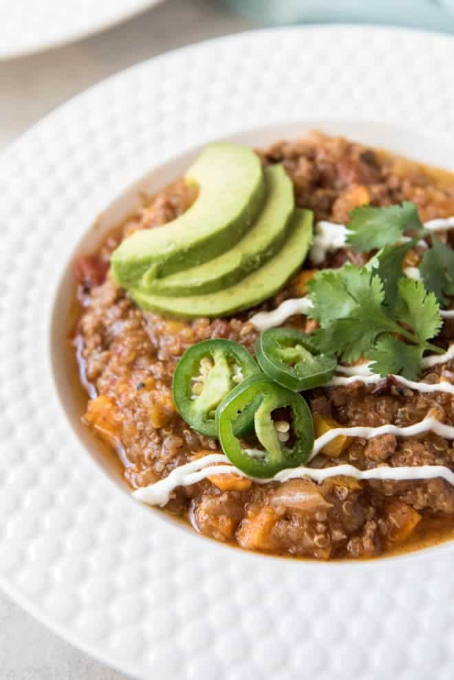 Instant Pot Turkey Chili with Sweet Potato and Quinoa is a healthier take on your favorite hearty chili! This meal is a fall favorite that the whole family will love and it cooks in the Instant Pot for an easy weeknight dinner. #turkey #chili #sweetpotato #instantpot #pressurecooker #dinner #recipe #weeknightmeal