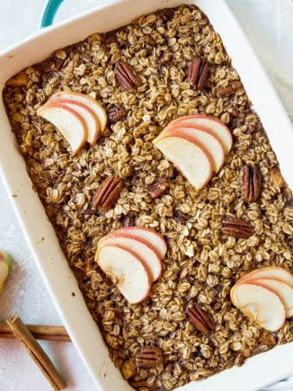 A large casserole dish filled with apple cinnamon baked oatmeal