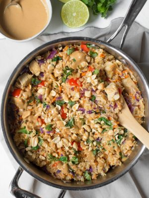 Thai Chicken Peanut Rice Skillet is an easy one pot meal that cooks in less than 30 minutes! It's packed with red bell peppers, carrots, cabbage, baby bok choy, chicken, rice and a creamy peanut sauce. #chicken #peanut #skillet #dinner #weeknight #meal