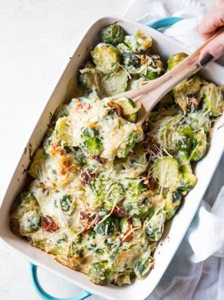 Brussels sprouts in a casserole dish with cheese.