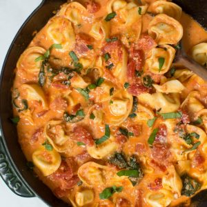 Combine a few simple ingredients to create a Creamy Tomato Basil Tortellini Skillet made in less than 30 minutes! The skillet is packed with fresh flavor and hearty ingredients. #tomato #basil #tortellini #pasta #skillet #dinner #recipe #creamy