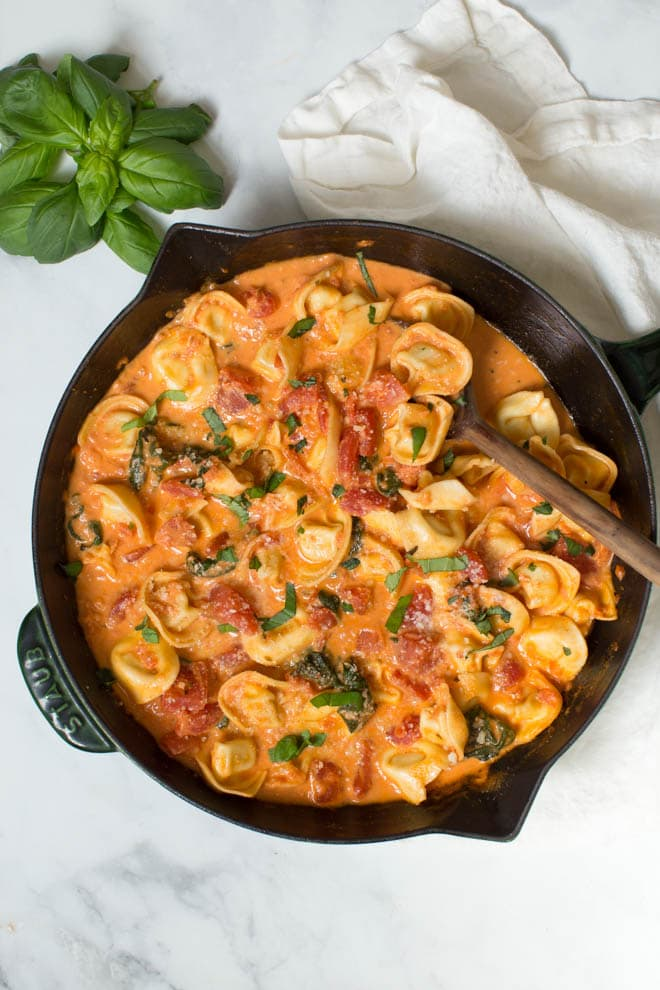 Combine a few simple ingredients to create a Creamy Tomato Basil Tortellini Skillet made in less than 30 minutes! The skillet is packed with fresh flavor and hearty ingredients. #tomato #basil #tortellini #pasta #skillet #dinner #recipe #onepot