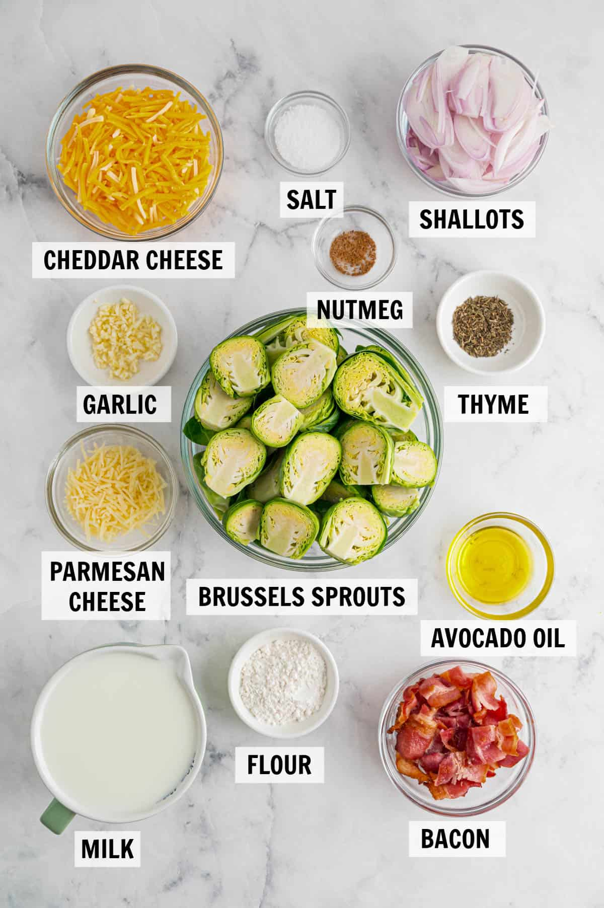 all of the ingredients for brussels sprouts au gratin on a white countertop