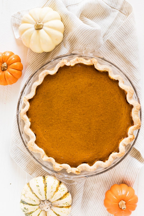 Pumpkin pie from scratch is a must during the fall baking season. Use this recipe to make a delicious homemade pie with a crust made from scratch! #pumpkin #pie #fromscratch #dessert #recipe #sweet
