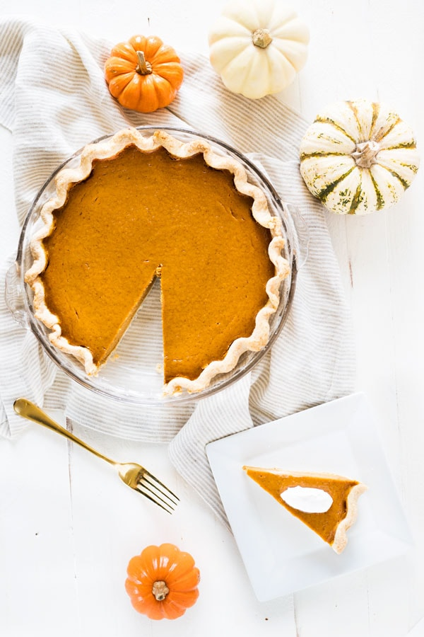 Pumpkin pie from scratch is a must during the fall baking season. Use this recipe to make a delicious homemade pie with a crust made from scratch! #pumpkin #pie #fromscratch #dessert #recipe #homemade #treat
