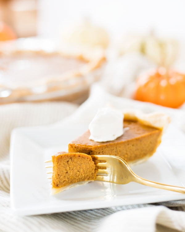 Pumpkin pie from scratch is a must during the fall baking season. Use this recipe to make a delicious homemade pie with a crust made from scratch! #pumpkin #pie #fromscratch #dessert #recipe #slice