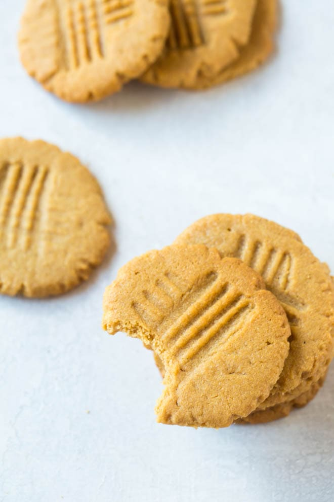 If you are looking for the best peanut butter cookies, these 3 ingredient peanut butter cookies are a crowd favorite! The cookies are made with only three ingredients and are the perfect treat for holiday cookie swaps and parties. #peanut #butter #cookies #holiday #cookieswap #peanutbutter #recipe #easy #dessert #glutenfree