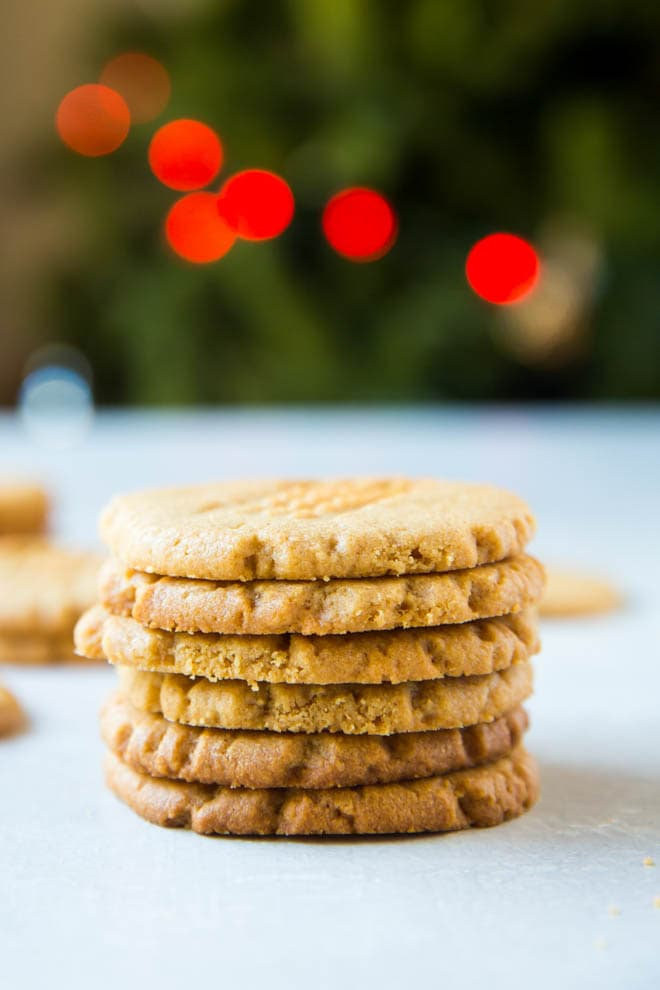 If you are looking for the best peanut butter cookies, these 3 ingredient peanut butter cookies are a crowd favorite! The cookies are made with only three ingredients and are the perfect treat for holiday cookie swaps and parties. #peanut #butter #cookies #holiday #cookieswap #peanutbutter #recipe #easy #dessert #glutenfree #flourless
