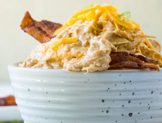 Slow Cooker Buffalo Chicken Dip is a crowd-favorite appetizer recipe that's super easy to prepare! It's the perfect appetizer to bring to your next party or tailgate and is made in the crock pot or slow cooker using frank's red hot sauce. #buffalo #chicken #dip #slowcooker #crockpot #recipe #holiday